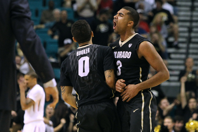 Colorado guard Xavier Talton celebrates a 3-point basket by teammate Askia Booker during the second half of their Pac-12 Conference tournament game against Oregon State Wednesday, March 11, 2015,  ...