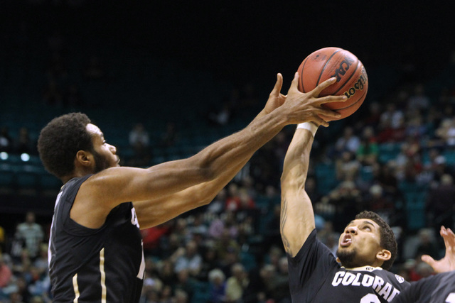 Colorado guards Tre'Shaun Fletcher, left, and Askia Booker reach for a rebound during the second half of their Pac-12 Conference tournament game Wednesday, March 11, 2015, at the MGM Grand Garden  ...