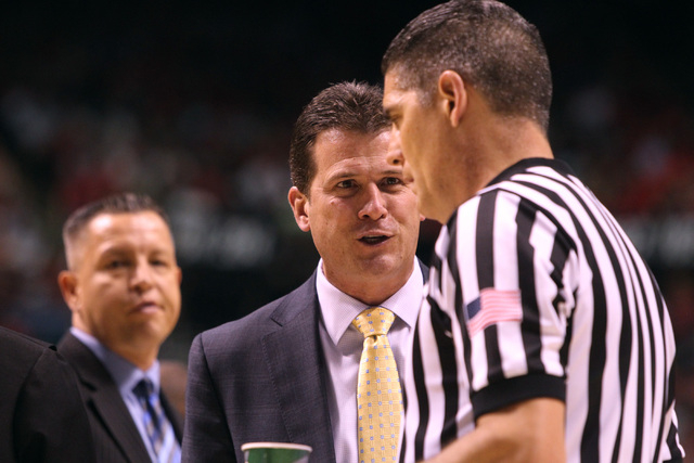 UCLA head coach Steve Alford asks official Mike Reed to be more consistent in his foul calls during the first half of their Pac 12 Conference semifinal tournament game against Arizona Friday, Marc ...