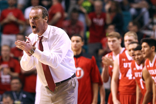 Utah head coach Larry Krystkowiak yells to his players during the second half of their Pac 12 Conference semifinal tournament game against Oregon Friday, March 13, 2015 at the MGM Grand Garden Are ...