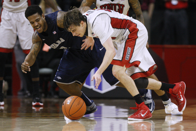 UNLV guard Cody Doolin steals the ball from UNR guard Tyron Criswell during the first half of their Mountain West Conference tournament game Wednesday, March 11, 2015, at the Thomas & Mack Center. ...