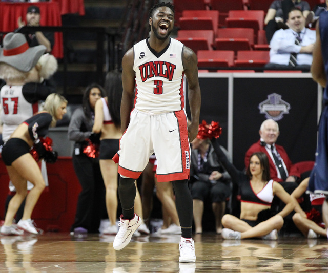 UNLV guard Jordan Cornish celebrates his second 3-point basket in a row against UNR during the first half of their Mountain West Conference tournament game Wednesday, March 11, 2015, at the Thomas ...
