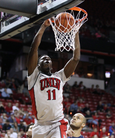 UNLV forward Goodluck Okonoboh dunks on UNR during the first half of their Mountain West Conference tournament game Wednesday, March 11, 2015, at the Thomas & Mack Center. (Sam Morris/Las Vegas Re ...