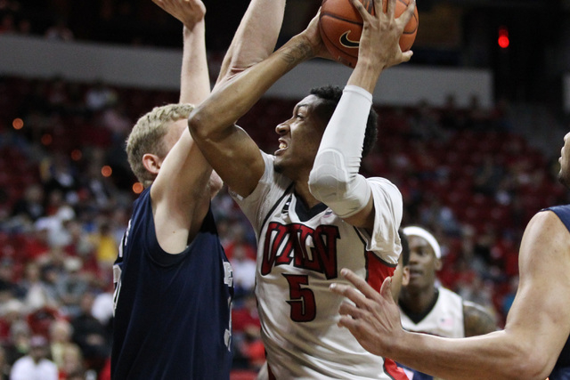 UNLV forward Chris Wood drives to the basket while being guarded by UNR forward Lucas Stivrins during the first half of their Mountain West Conference tournament game Wednesday, March 11, 2015, at ...