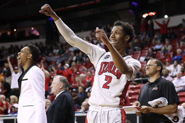 UNLV guard Patrick McCaw celebrates teammate Charles Rushman's basket during the second half of their Mountain West Conference tournament game Wednesday, March 11, 2015, at the Thomas & Mack Cente ...