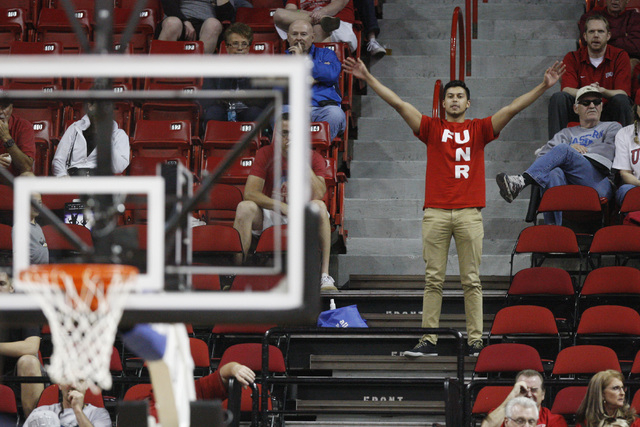 A UNLV fan tries to distract at free throw attempt by UNR during the second half of their Mountain West Conference tournament game Wednesday, March 11, 2015, at the Thomas & Mack Center. UNLV won  ...