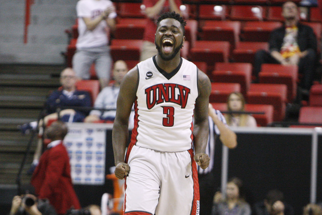 UNLV guard Jordan Cornish celebrates a 3-point basket against UNR during the second half of their Mountain West Conference tournament game Wednesday, March 11, 2015, at the Thomas & Mack Center. U ...