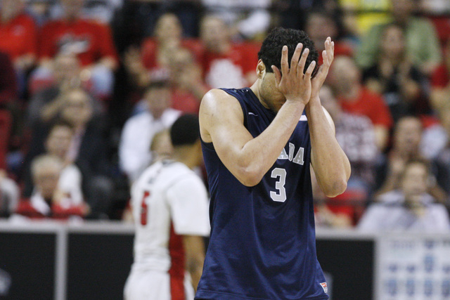 UNR forward A.J. West rubs his eyes as UNLV pulls ahead during the second half of their Mountain West Conference tournament game Wednesday, March 11, 2015, at the Thomas & Mack Center. UNLV won 67 ...