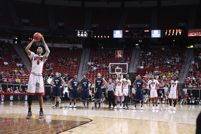UNLV forward Chris Wood shoots a free throw after UNR guard Marqueze Coleman was called for a technical foul during the second half of their Mountain West Conference tournament game Wednesday, Mar ...