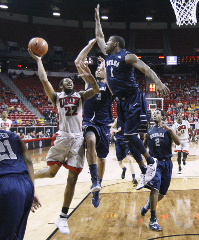 UNR forward A.J. West, center, and guard Marqueze Coleman leap to defend a shot by UNLV guard Jelan Kendrick during the second half of their Mountain West Conference tournament game Wednesday, Mar ...
