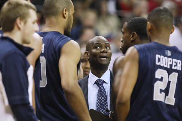 UNR head coach David Carter talks to his team during a time out in the first half of their Mountain West Conference tournament game against UNLV Wednesday at the Thomas & Mack Center. Carter was r ...