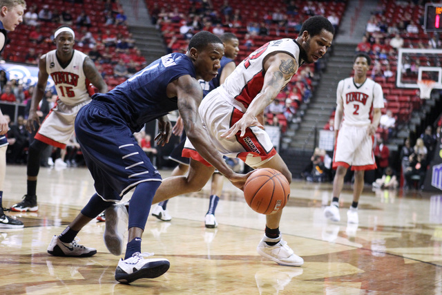UNR guard Marqueze Coleman steals the ball from UNLV guard Jelan Kendrick during the first half of their Mountain West Conference tournament game Wednesday, March 11, 2015, at the Thomas & Mack Ce ...