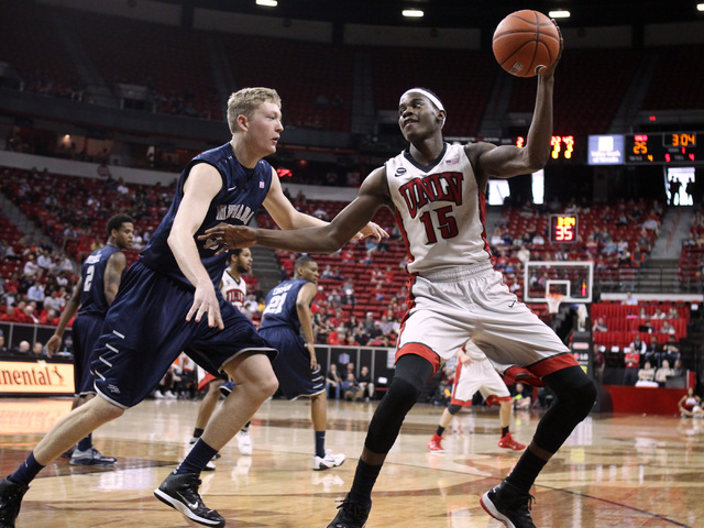 UNR forward Lucas Stivrins defends UNLV forward Dwayne Morgan during the first half of their Mountain West Conference tournament game Wednesday, March 11, 2015, at the Thomas & Mack Center. (Sam M ...