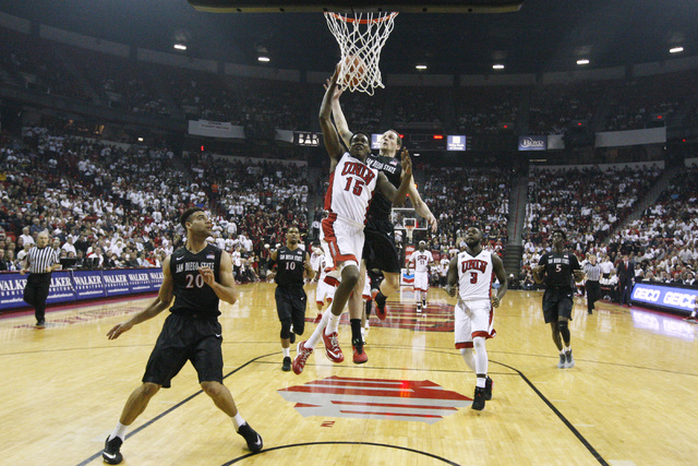 UNLV forward Dwayne Morgan drives to the basket and is fouled by San Diego State forward Matt Shrigley during the first half of their Mountain West Conference game Wednesday, March 4, 2015, at the ...
