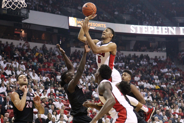 UNLV forward Christian Wood shoots over the top of San Diego State forward Angelo Chol during the first half of their Mountain West Conference game Wednesday, March 4, 2015, at the Thomas & Mack C ...