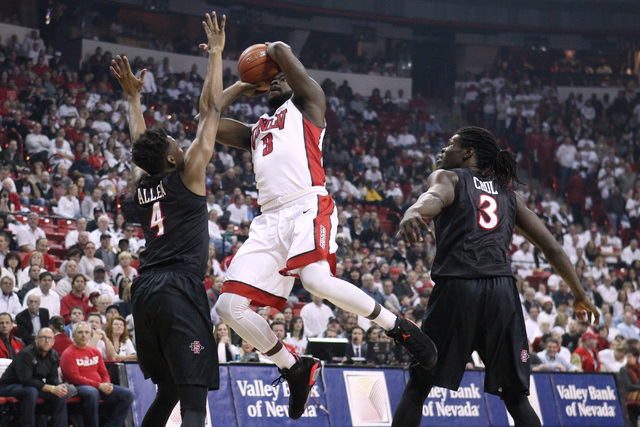 UNLV guard Jordan Cornish shoots over San Diego State guard Dakarai Allen during the first half of their Mountain West Conference game Wednesday, March 4, 2015, at the Thomas & Mack Center. (Sam M ...
