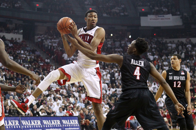 UNLV forward Christian Wood pulls down is own rebound while being defended by San Diego State guard Dakarai Allen during the first half of their Mountain West Conference game Wednesday, March 4, 2 ...