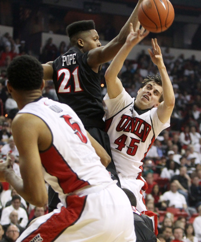 UNLV guard Cody Doolin shoots and is fouled by San Diego State forward Malik Pope during the first half of their Mountain West Conference game Wednesday, March 4, 2015, at the Thomas & Mack Center ...
