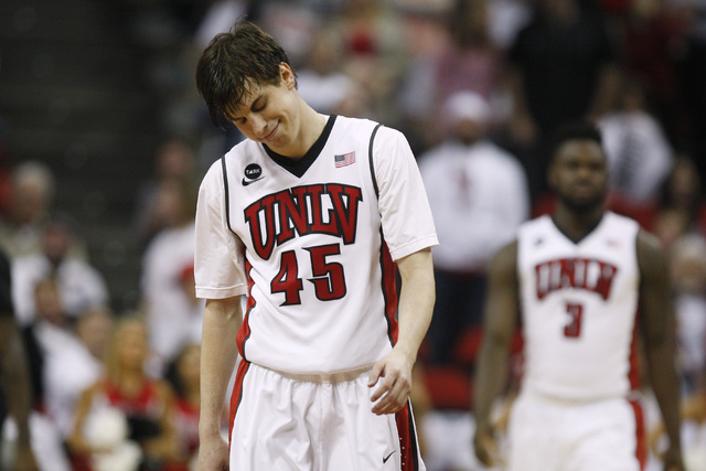 UNLV guard Cody Doolin heads to the bench for a time out after having a shot rejected during the second half of their Mountain West Conference game against San Diego State Wednesday, March 4, 2015 ...