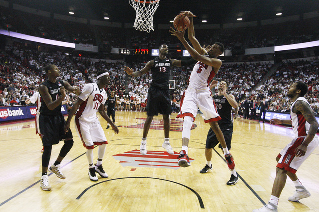 UNLV forward Christian Wood pulls down a rebound against San Diego State during the second half of their Mountain West Conference game Wednesday, March 4, 2015, at the Thomas & Mack Center. San Di ...