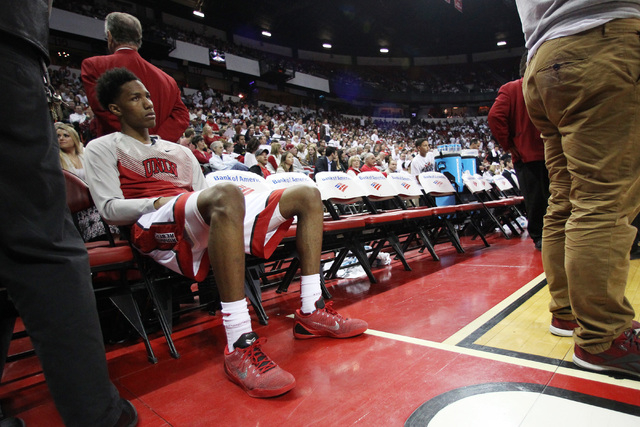 UNLV guard Patrick McCaw sits on the bench after suffering a head injury and displaying concussion-like symptoms during the second half of their Mountain West Conference game against San Diego Sta ...