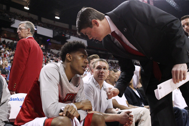 UNLV head coach Dave Rice checks on guard Patrick McCaw after McCaw suffered a head injury and displayed concussion-like symptoms during the second half of their Mountain West Conference game agai ...