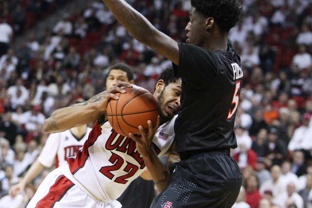 UNLV guard Jelan Kendrick drives into San Diego State forward Dwayne Polee II during the second half of their Mountain West Conference game Wednesday, March 4, 2015, at the Thomas & Mack Center. S ...