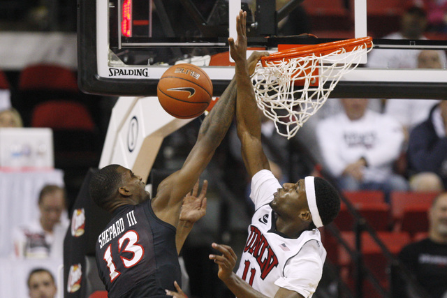UNLV forward Goodluck Okonoboh blocks a shot by San Diego State forward Winston Shepard during the second half of their Mountain West Conference game Wednesday, March 4, 2015, at the Thomas & Mack ...