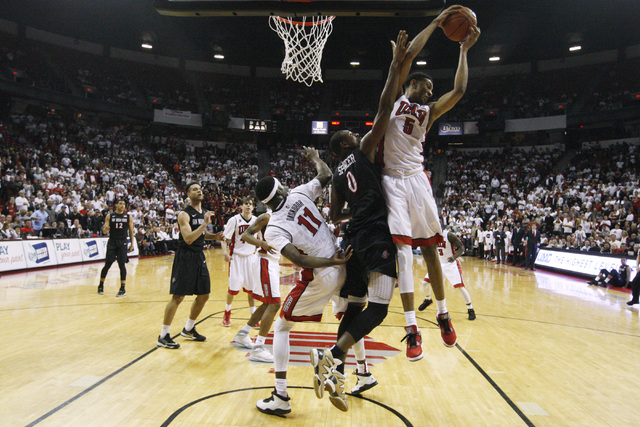 UNLV forward Christian Wood grabs a rebound from San Diego State forward Skylar Spencer during the second half of their Mountain West Conference game Wednesday, March 4, 2015, at the Thomas & Mack ...