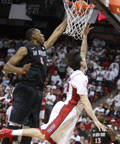 UNLV guard Cody Doolin has his shot blocked by San Diego State forward Skylar Spencer late in the second half of their Mountain West Conference game Wednesday, March 4, 2015, at the Thomas & Mack  ...