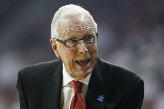 San Diego State head coach Steve Fisher talks to his players during the first half of their Mountain West Conference game against UNLV Wednesday, March 4, 2015, at the Thomas & Mack Center. (Sam M ...