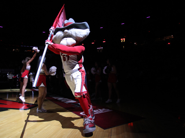 Hey Reb runs out the UNLV flag before their Mountain West Conference game against San Diego State Wednesday, March 4, 2015, at the Thomas & Mack Center. (Sam Morris/Las Vegas Review-Journal)