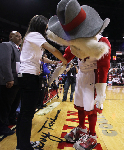 Hey Reb has help getting his pyrotechnic gloves on before their Mountain West Conference game against San Diego State Wednesday, March 4, 2015, at the Thomas & Mack Center. (Sam Morris/Las Vegas R ...