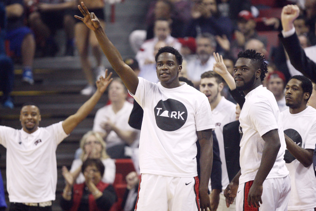 UNLV forward Dwayne Morgan, center, and the rest of the Rebels bench celebrate a successful 3-point shot against San Diego State during the first half of their Mountain West Conference game Wednes ...