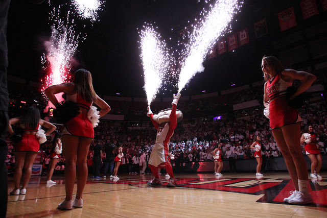 Hey Reb fires off his pyrotechnic gloves during the opening show before their Mountain West Conference game against San Diego State Wednesday, March 4, 2015, at the Thomas & Mack Center. (Sam Morr ...