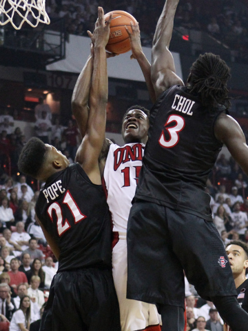 UNLV forward Dwayne Morgan is defended by San Diego State forwards Malik Pope and Angelo Chol during the first half of their Mountain West Conference game Wednesday, March 4, 2015, at the Thomas & ...