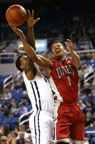 Nevada's Tyrone Criswell (2) fouls UNLV's Rashad Vaughn (1) during a college basketball game in Reno, Nev., on Tuesday, Jan. 27, 2015. (Las Vegas Review-Journal/Cathleen Allison)