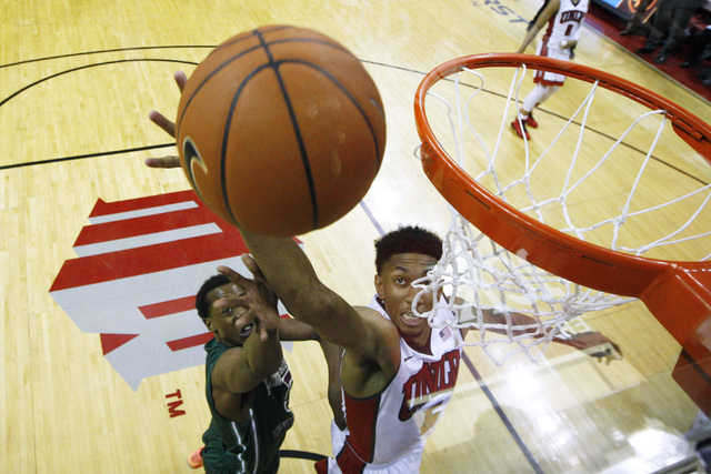 UNLV forward Christian Wood grabs a rebound from Florida National University forward Jarvis Davis during their exhibition game Wednesday, Nov. 5, 2014 at the Thomas & Mack Center in Las Vegas. UNL ...