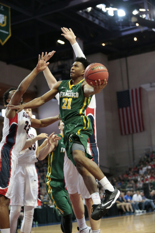 San Francisco Dons Guard, Devin Watson leaps high towards the basket, while surrounded by Gonzaga defenders during the Western Athletiic Conference Championship tournament Quarterfinal 3: Gonzaga  ...