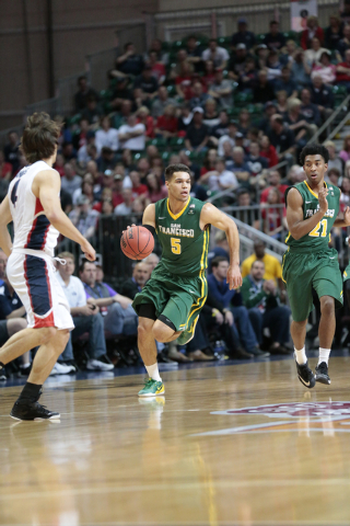 San Francisco Dons G Matt Glover (5) moves the ball down court during the Western Athletic Conference Championship tournament Quarterfinal 3: Gonzaga Bulldogs vs. San Francisco Dons at the Orleans ...