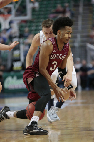 Santa Clara Guard Brandon Clark (3) stumbles with the ball between his legs during first half of the Western Athletic Conference Championship tournament Quarterfinal 34 BYU vs. Santa Clara at the  ...