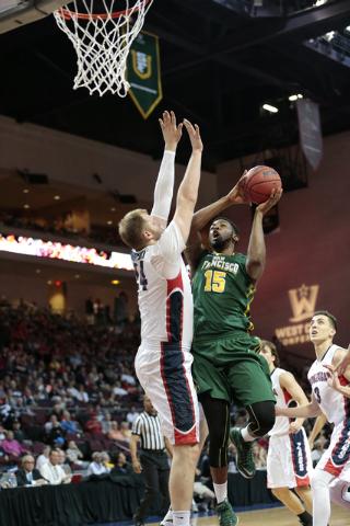 San Francisco Dons F-C Kruize(cq) Pinkins (15) goes up for a basket defended by Gonzaga University C Przemek Karnowski (24) during the Western Athletic Conference Championship tournament Quarterfi ...