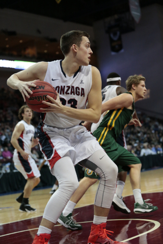 Gonzaga University F Kyle Wiltjer (33) holds onto the ball after coming up with the rebound during the Western Athletic Conference Championship tournament Quarterfinal 3: Gonzaga Bulldogs vs. San  ...