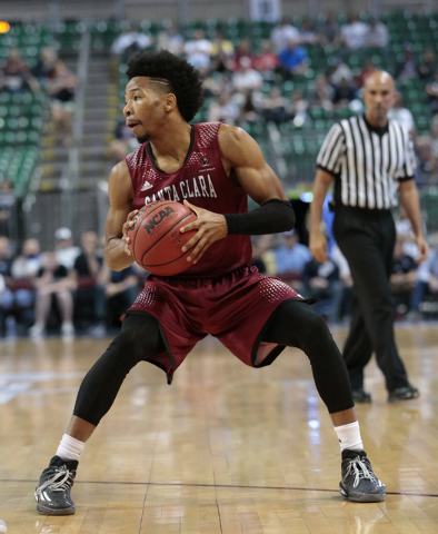 Santa Clara Guard Brandon Clark (3) prepares to make a pass to a team member during first half of the Western Athletic Conference Championship tournament Quarterfinal 34 BYU vs. Santa Clara at the ...