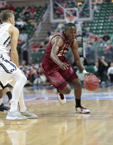 Santa Clara Guard Jared Brownridge (23) moves the ball forward while a BYU defender readies to block him during first half of the Western Athletic Conference Championship tournament Quarterfinal 3 ...