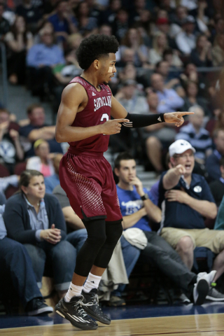 Santa Clara Guard Brandon Clark (3) points to other team members to pass the ball during first half of the Western Athletic Conference Championship tournament Quarterfinal 34 BYU vs. Santa Clara a ...