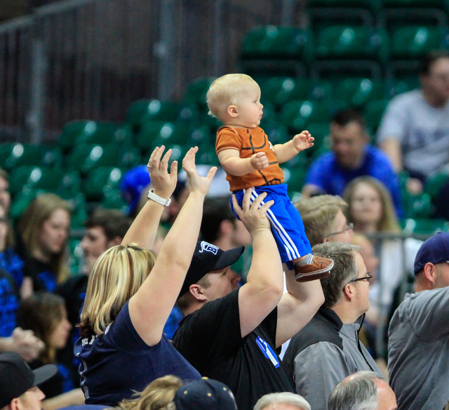 A young BYU fan views the game while lifted above his fathers head during second half of the Western Athletic Conference Championship tournament Quarterfinal 4: BYU vs. Santa Clara at the Orleans  ...