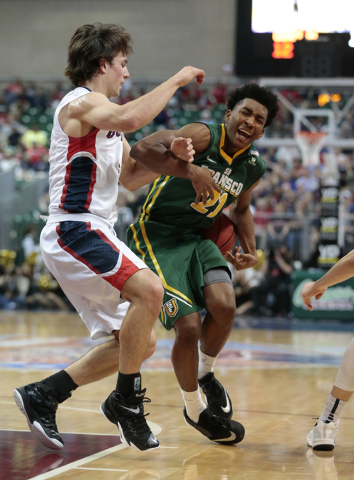 Gonzaga University G Kevin Pangos (4) left, defends against San Francisco Dons G Devin Watson (21) as he moves the ball up down the court during the Western Athletic Conference Championship tourna ...