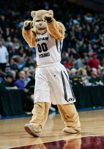 The BYU cougar mascot works the spectators during a time out in the second half of the Western Athletic Conference Championship tournament Quarterfinal 4: BYU vs. Santa Clara at the Orleans Arena  ...