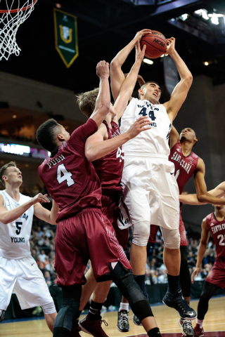 BYU center Corbin Kaufusi (cq) (44) retrieves the rebound while several Santa Clara defenders attempt to grab the ball from him during second half of the Western Athletic Conference Championship t ...